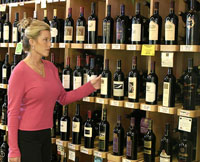 woman choosing organic wine